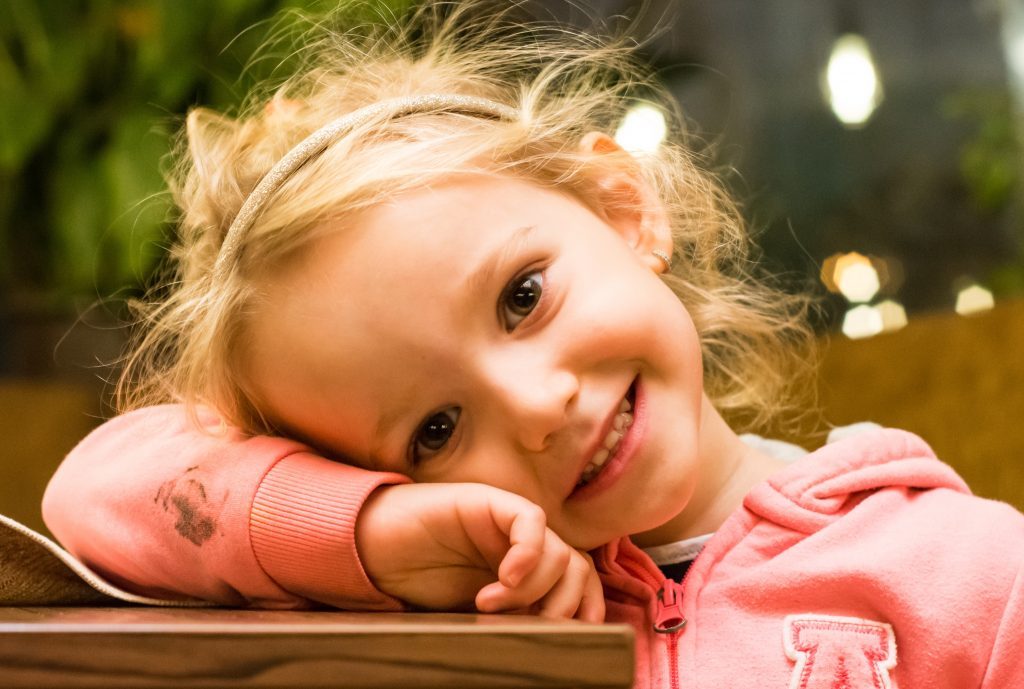 Sweet little girl smiling. Where can you fine the best example of Godlike love