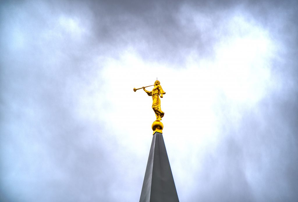 Angel Moroni in a cloudy sky
