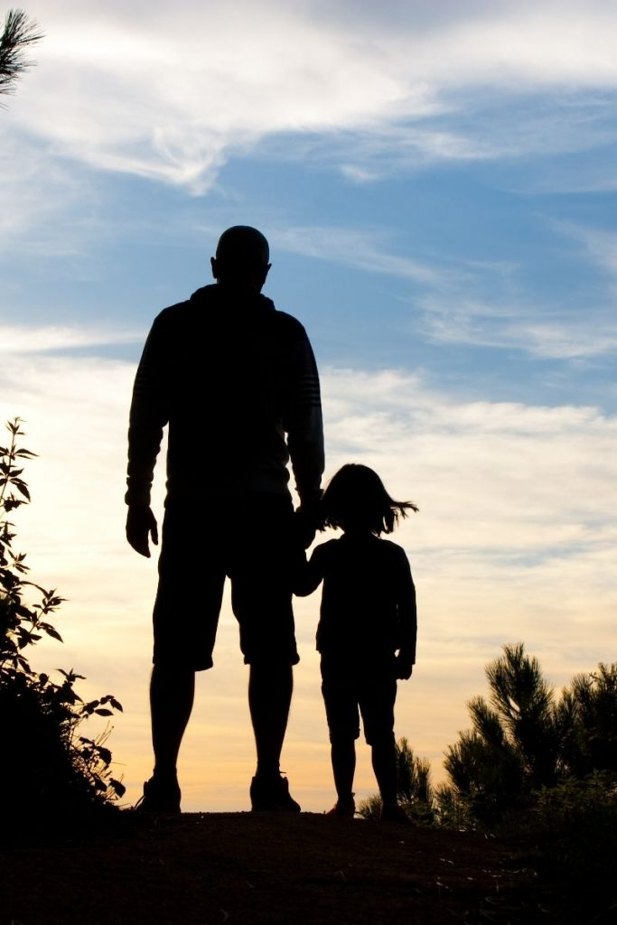 Help your children follow the covenant path. adult and child sillouitted in sunset